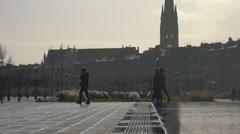 Happy people walking in rain, enjoying weekend in European city center, tourism Stock Footage