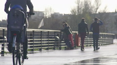 Parents riding bikes with their kids, family values, happy weekend. Slow motion - stock footage
