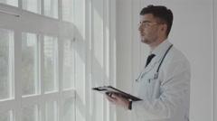 Doctor working near window in a hospital. 4K Stock Footage