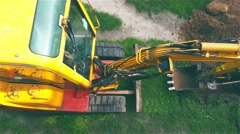 Excavator digging a trench for laying cables Stock Footage