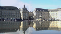 People walking near fountain, amazing view on Place Royale in France, cityscape Stock Footage