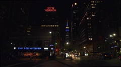 Empire State Building: red, white, blue, static nighttime shot Stock Footage