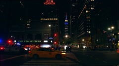 Empire State Building: red, white, blue, nighttime static shot, police vehicle t Stock Footage