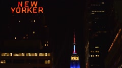Empire State Building: Top of ESB & New Yorker Hotel sign, nighttime static shot Stock Footage