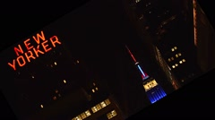 Empire State Building: dramatic, strong tilt, top of ESB and New Yorker Hotel si Stock Footage