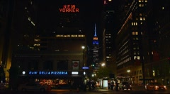 Empire State Building: blue/gold, New Yorker Hotel, pizzeria & police car in for Stock Footage