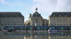 Modern tram moving in Bordeaux city center, public transportation, city traffic Stock Footage