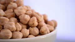 Chickpeas vegetables gyrating on a bowl on white background Stock Footage