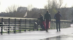 Parents riding bicycles with their children along embankment, enjoying weekend Stock Footage