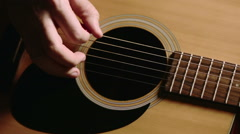 man with an acoustic guitar, right hand playing - stock footage