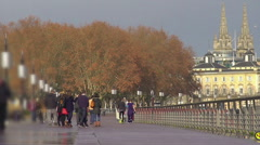 Relaxed people walking along embankment, enjoying beautiful city view, weekend Stock Footage