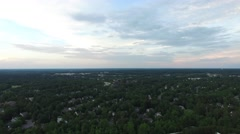 Flying above suburban Cary, NC near sunset in June. Stock Footage