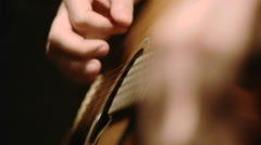 man playing acoustic guitar solo, rack focus on both hands - stock footage