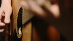 man playing acoustic guitar solo, abstract shot - stock footage