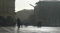 Sleet falling on asphalt, people walking under umbrellas, bad weather conditions Stock Footage