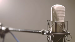 Backlit microphone on a stand, rack focus Stock Footage