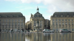 Tourists riding bicycles near fountain at Place de la Bourse in Bordeaux, France Stock Footage