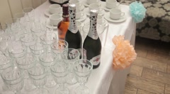 Bottle of sparkling wine and wine glasses are on the table Stock Footage
