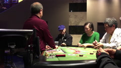 People playing baccarat game inside Grand Villa Casino Stock Footage