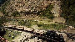 Model Train Carrying Lumber/Logs Stock Footage