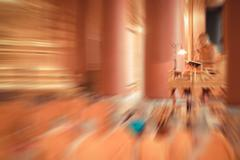 Blurred zoom of Thai monk worship in temple Stock Photos