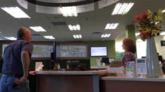 Customer asking question with receptionist inside TD Bank - stock footage