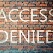 Red Brick wall texture with a word Access Denied - stock photo
