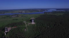 A huge radio telescope in the forest. Volga river in background. - stock footage