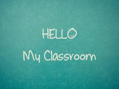 Green blackboard wall texture with a word Hello My Classroom - stock photo