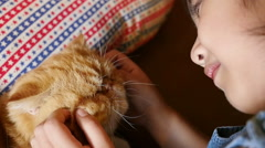 Slow motion Lovely Asian girl plays with her tabby Persian cat Stock Footage