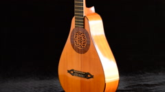 Ancient pear guitar manufactured by a luthier gyrating - stock footage