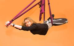 Woman making aerial yoga exercises, indoor Stock Photos