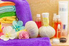 Composition with spa products: towels, pouches, flowers orchid, bottles, crea - stock photo