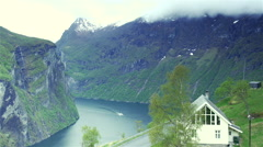 Beautiful Norwegian landscape with sailing boat in fjord ,high viewpoint Stock Footage