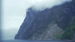 Movement along the Norwegian fjord surrounded by fog Stock Footage