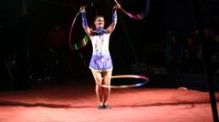 Glybokaya, Ukraine-March 27, 2016. Circus show girls with hoops Stock Footage