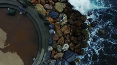 Vertical video, a surfer on the rocks. Aerial drone video N. - stock footage