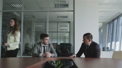 Two businessmen in the office signed a contract. Stock Footage