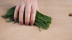 Cutting dill on the table. Stock Footage