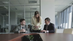 Beautiful girl manager works with clients in the office. Stock Footage
