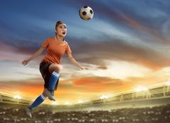 Female soccer player heading ball Stock Photos