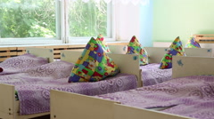 Beds with pillows in kindergarten - stock footage