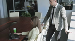 The attractive girl and the guy working in the office. - stock footage