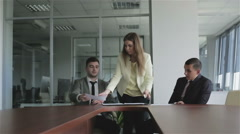 Young woman lawyer putting the signed documents in a black folder. - stock footage