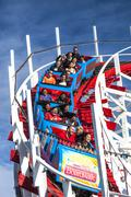 People on Giant Dipper roller coaster, Santa Cruz, California - stock photo