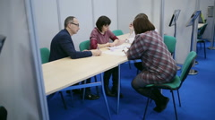 The man with glasses and two women lead the discussion Stock Footage