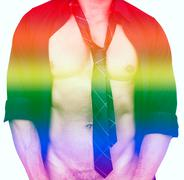 muscular male torso and rainbow colors for gay pride - stock photo