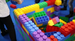 Children build a house out of Lego bricks large Stock Footage