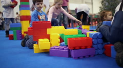 Kids playing with large Lego cubes Stock Footage