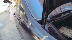Wedding black car with dollar briefcase - stock footage